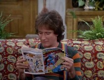 Mork reading Superman comic